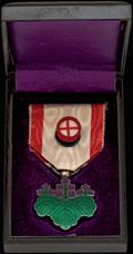 Знак ордена Восходящего солнца VII степени (медаль зеленой павлонии)
