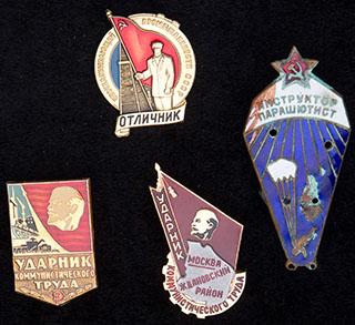 Лот из знаков СССР на различную тематику. 4 шт.